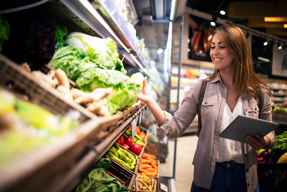 beautiful woman buying vegetables healthy food supermarket1 - Sora Solutions Services